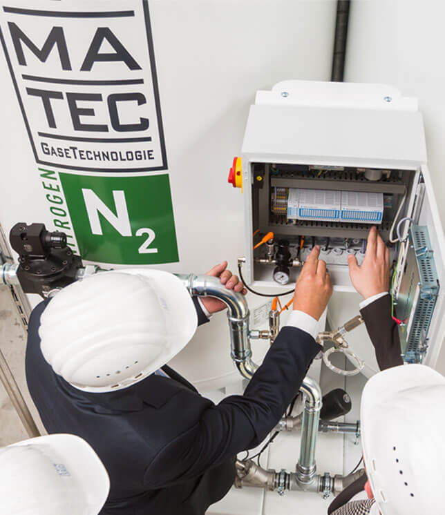 INMATEC nitrogen generator hanled by employees